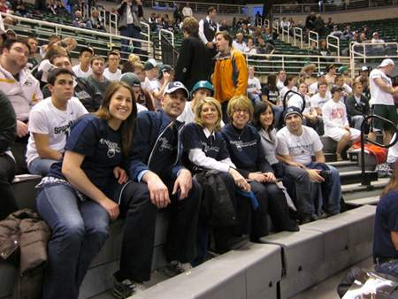 World Campus staff, students, and guests enjoy a night of Penn State basketball at the Breslin Student Events Center on the Michigan State campus. From left to right: guest Lauren Synko, student Kent Grantham, director of academic affairs for undergraduate programs Karen Pollack, academic adviser Donna Anderson, guest Gerica Hale, and student Shea Marks. Photo courtesy of Shubha Kashyap.