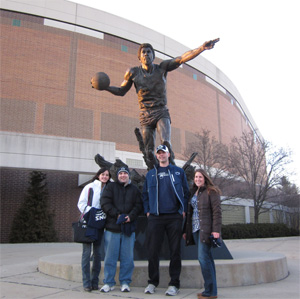 The students admitted they felt like they were betraying Penn State a bit by taking a photo by the Magic Johnson statue outside the Breslin Student Events Center. Photo courtesy of Shubha Kashyap.