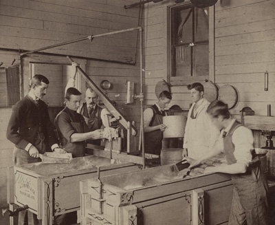 Students make ice cream in the Creamery in the 19th century. Courtesy of Penn State University Archives.