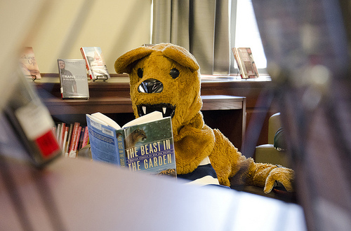 The Nittany Lion enjoying some leisure reading in Pattee-Paterno library on Penn State's University Park campus. Photo courtesy of Penn State News.