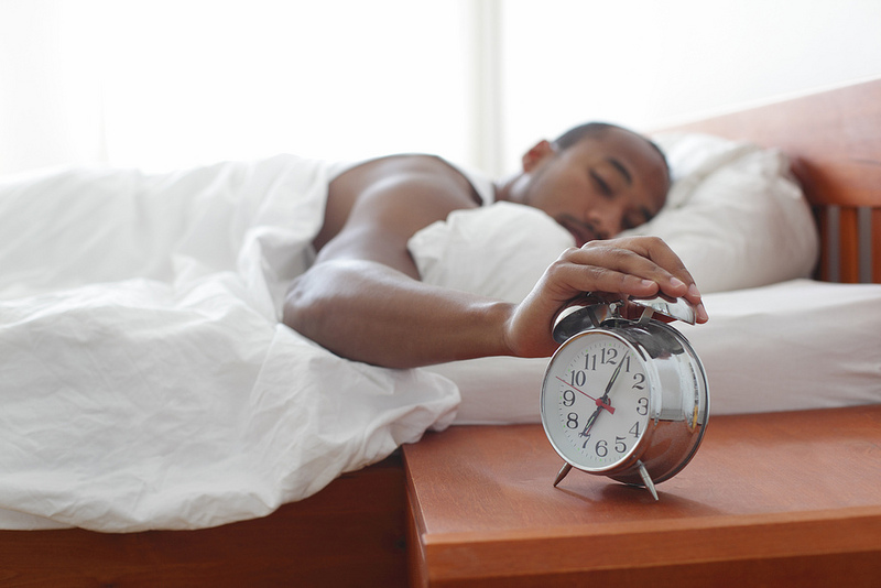 Person hitting snooze button