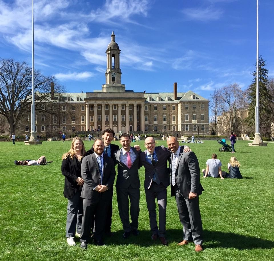 Jason Lin with fellow Penn State World Campus students in front of Old Main.
