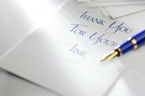 handwritten thank-you note with blue pen