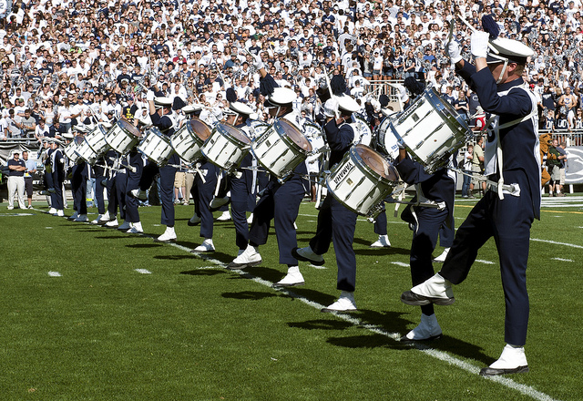 The Penn State Blue Band drumline takes the field to begin the pregame show. Photo courtesy of Penn State News.