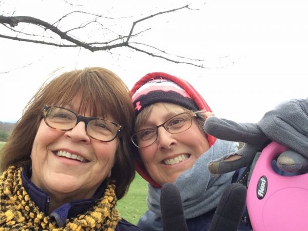 Betsy and Michelle enjoy a walk in the park