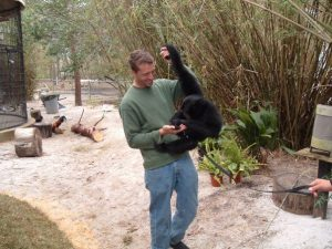 Zookeeper with siamang
